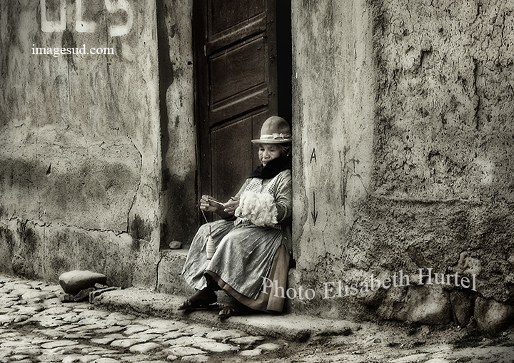Bw street, woman spinning the wool on her doorstep, Bolivia