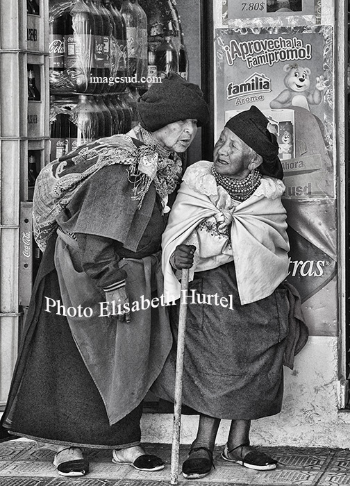 Small chat between friends, Ecuador street scene in bw