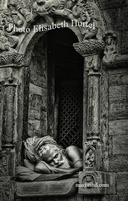 Sadhu asleep in a hindu temple, India