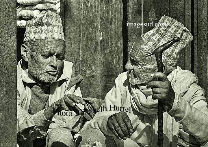 Small chat between friends, Nepal, bw street scene