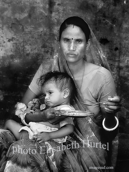 Mother and child, street scene in India, bw