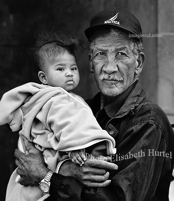Grand father and child, portrait black and white