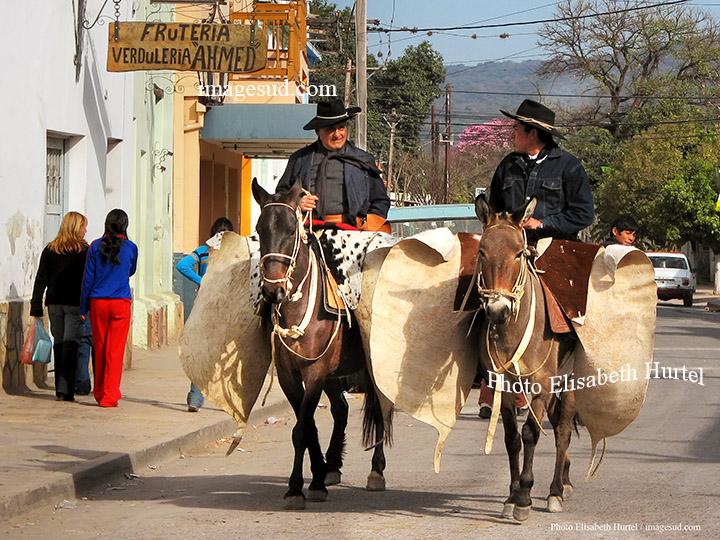 2 gauchos in a village street in Argentina